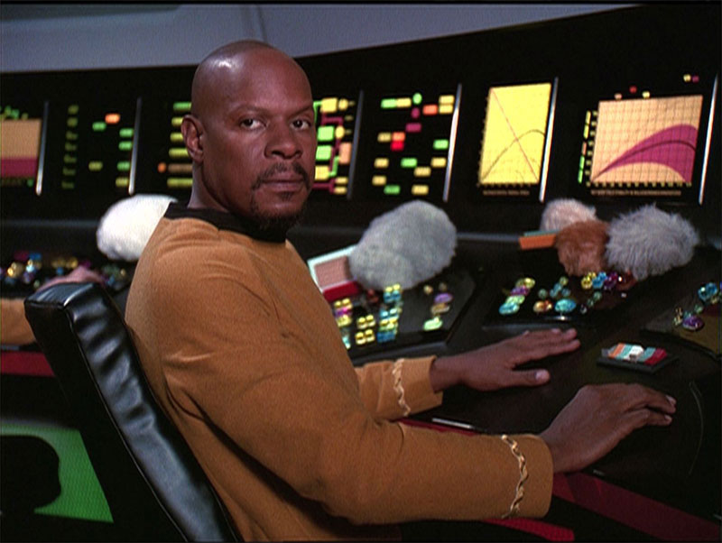 "Brooks in the DS9 fifth season episode ""Trials and Tribble-ations"""