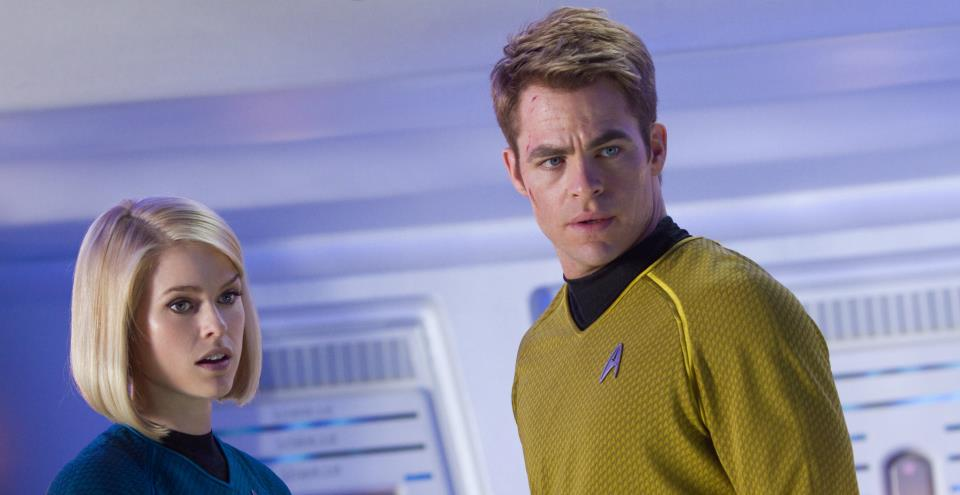 Alice Eve as Dr. Carol Marcus and Chris Pine as Captain Kirk