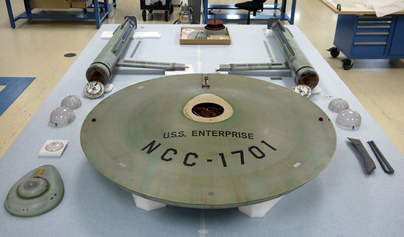 The Star Trek starship Enterprise model seperated into its component parts. As part of the conservation of the model, each original section will be studied to determine its construction and condition and will be documented with visible, ultraviolet, and infrared photography.