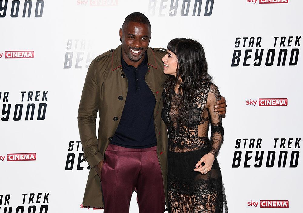 Idris Elba and Sofia Boutella stare a laugh