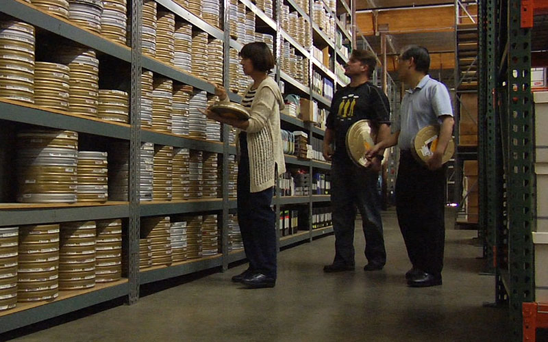 Denise Okuda, Rod Roddenberry and  Mike Okuda survey the reels of film