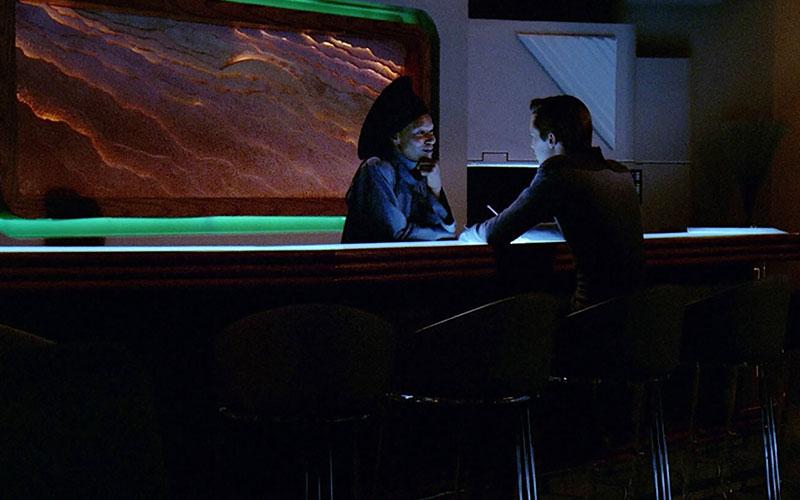 Guinan talks with Wesley Crusher in Ten Forward