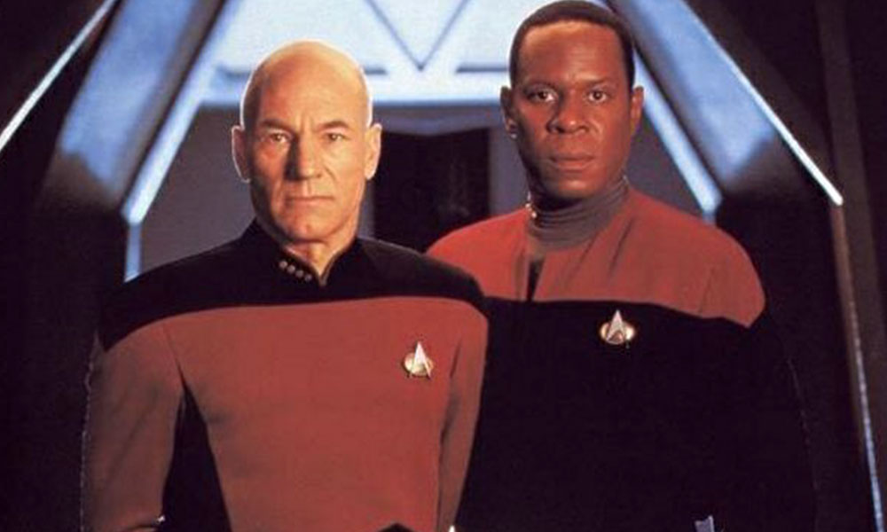 Patrick Stewart as Captain Picard and Avery Brooks as Captain Sisko
