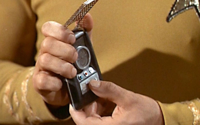 Captain Kirk holding a communicator on The Original Series