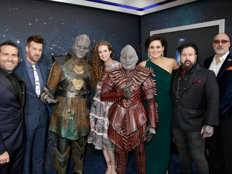 Members of the Star Trek: Discovery cast and crew with Klingons
