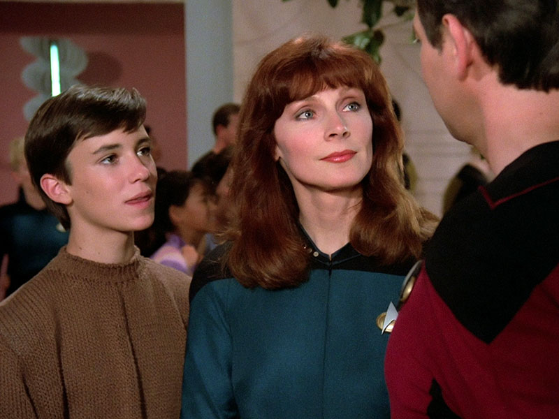 Wil Wheaton as Wesley Crusher, Gates McFadden as Beverly Crusher and Jonathan Frakes as William Riker