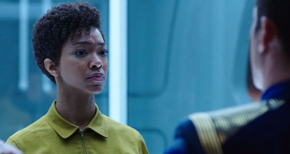 Sonequa Martin-Green as First Officer Michael Burnham opposite Jason Isaacs as Captain Gabriel Lorca