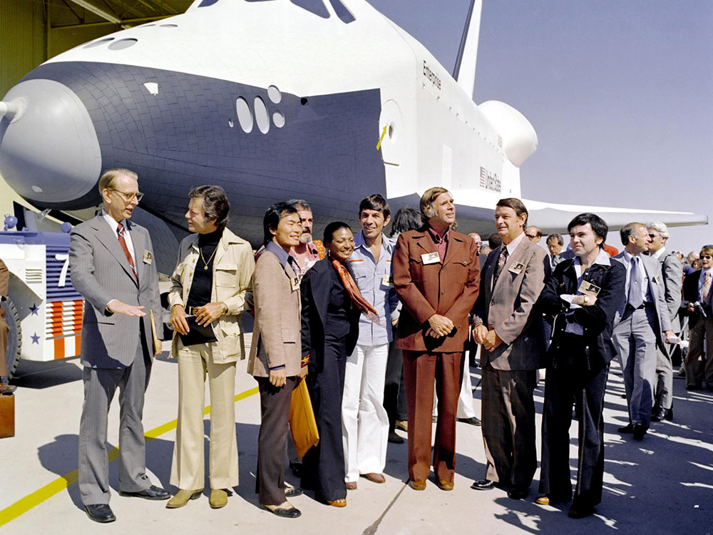 Gene and members of the Original Series cast along with NASA administrators attending Enterprise's rollout ceremony
