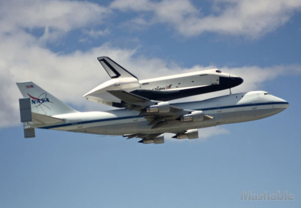 Shuttle Enterprise flys above New York City aboard a Boeing 747