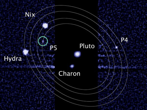 An image from the Hubble Space Telescope showing Pluto and its largest moon, Charon, along with four smaller moons. (Photo: M. Showalter / NASA / ESA)