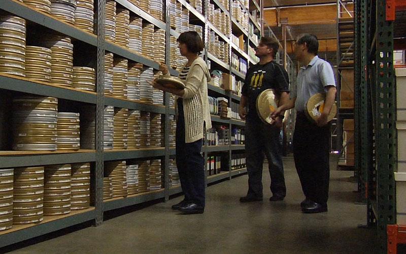Denise Okuda, Rod Roddenberry and Mike Okuda survey the reels of film