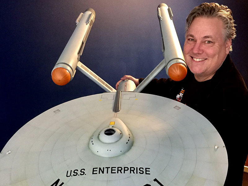 Burnett holding the Enterprise