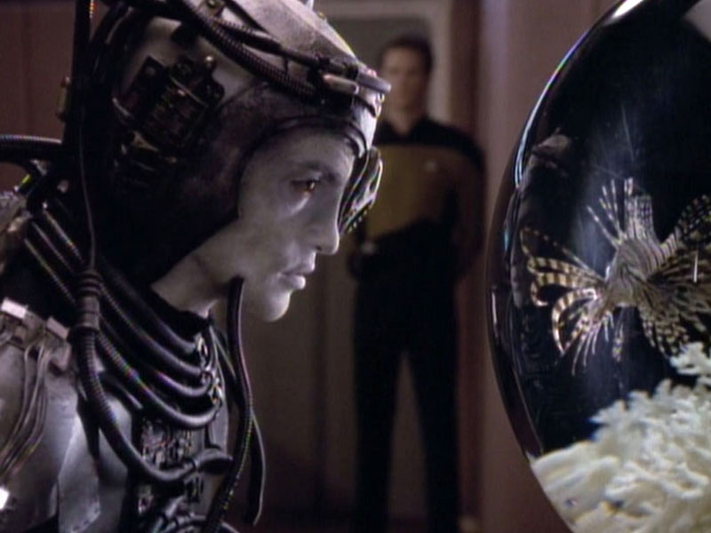 The Borg Hugh examines Picard's fish Livingston