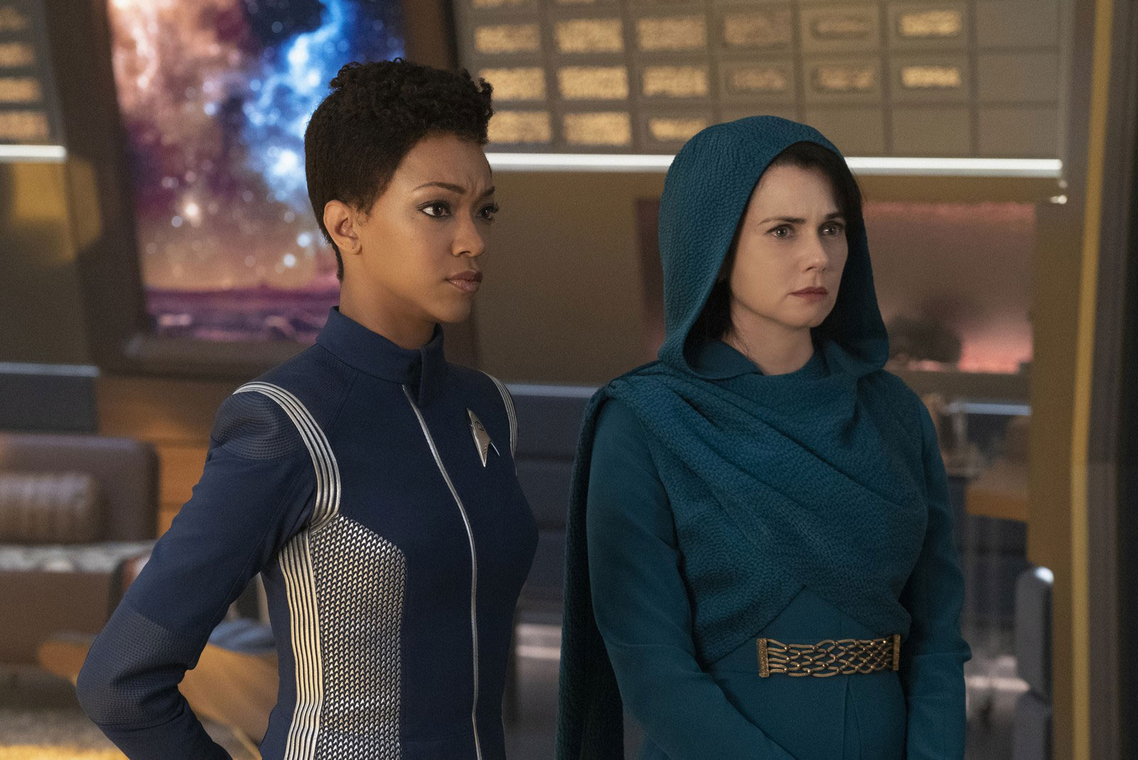 Sonequa Martin-Green as Commander Michael Burnham and Mia Kirshner as Amanda Grayson