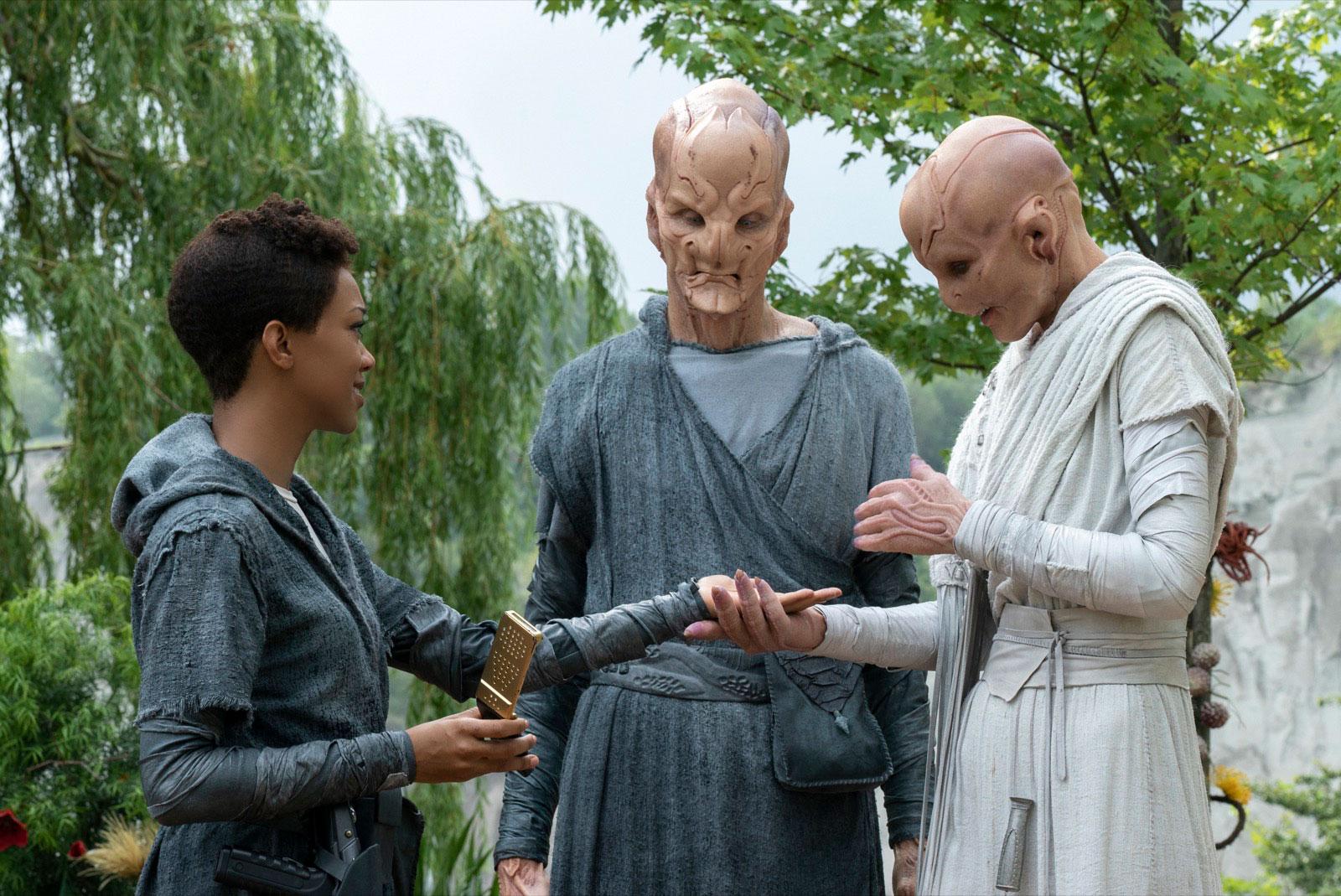 Sonequa Martin-Green as Michael Burnham, Doug Jones as Saru and Hannah Spear as Siranna