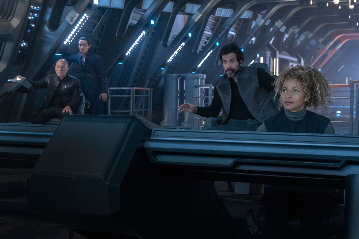 Patrick Stewart as Jean-Luc Picard, Evan Evagora as Elnor, Santiago Cabrera as Rios and Michelle Hurd as Raffi