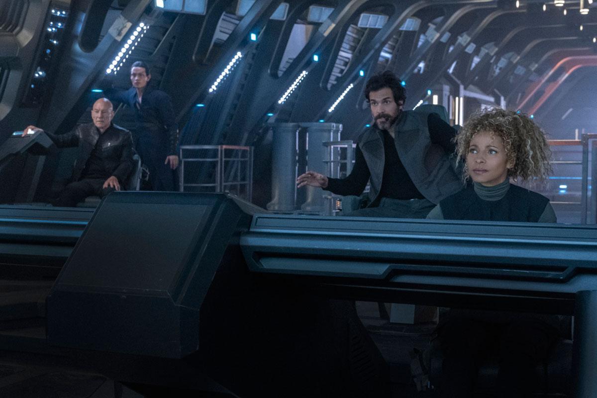 Patrick Stewart as Jean-Luc Picard, Evan Evagora as Elnor, Santiago Cabrera as Rios and Michelle Hurd as Raffi
