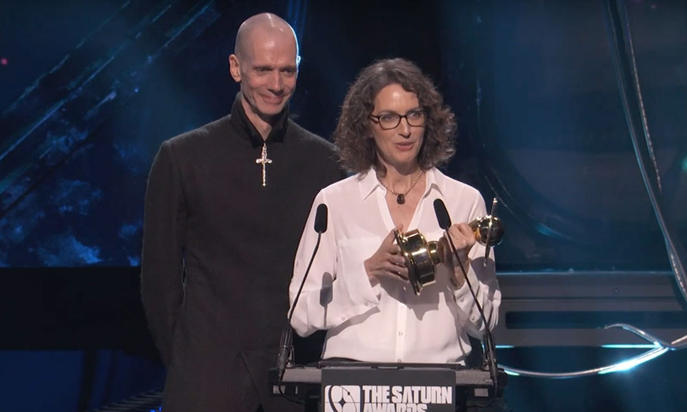 Doug Jones and Michelle Paradise accept the award for Best Streaming Science Fiction Show